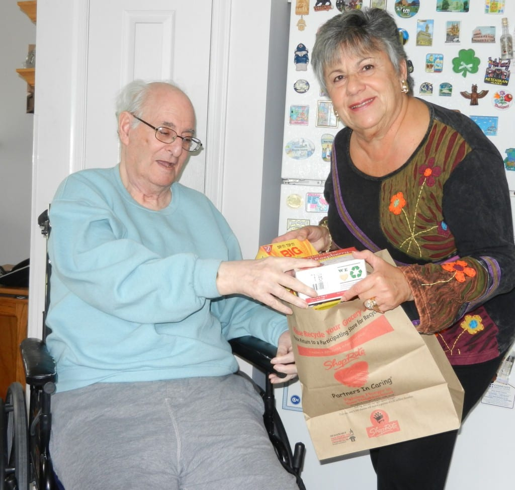 CVCJ Volunteer handing groceries to a recipient
